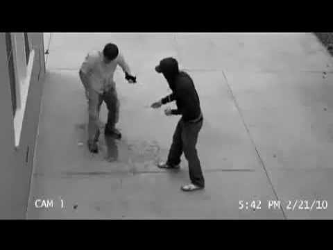 Guy pees his pants while getting robbed