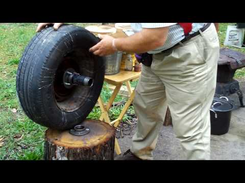 throw pottery on a car wheel and tire~by Hillar Bergman