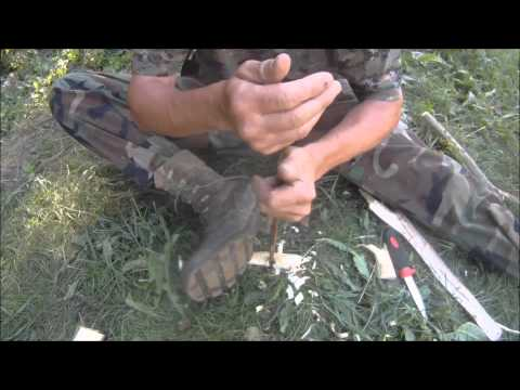 Making Fire with the Hand Drill method