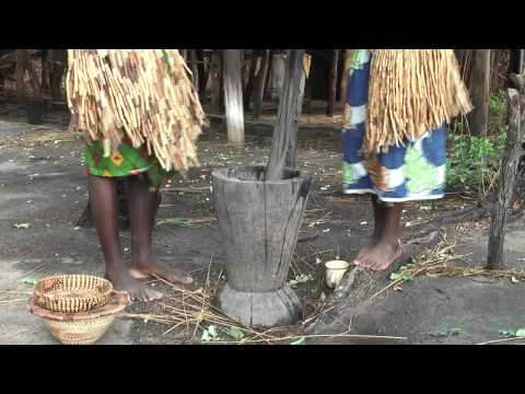 African native tribes - Bafue women grinding corn in a mortar