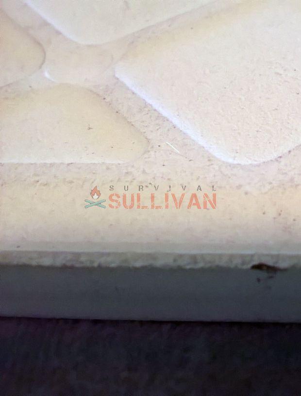 close up of back side of ceramic tile