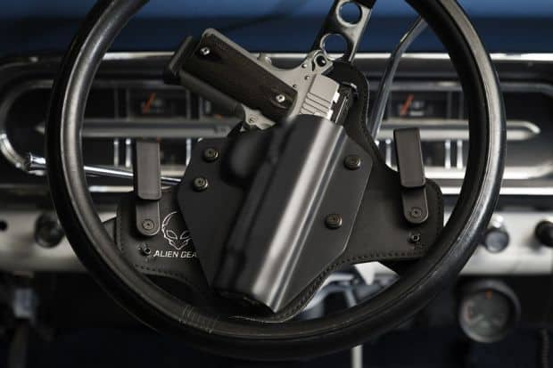 holster and gun on driving wheel