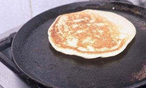 Cornmeal pancake on the griddle