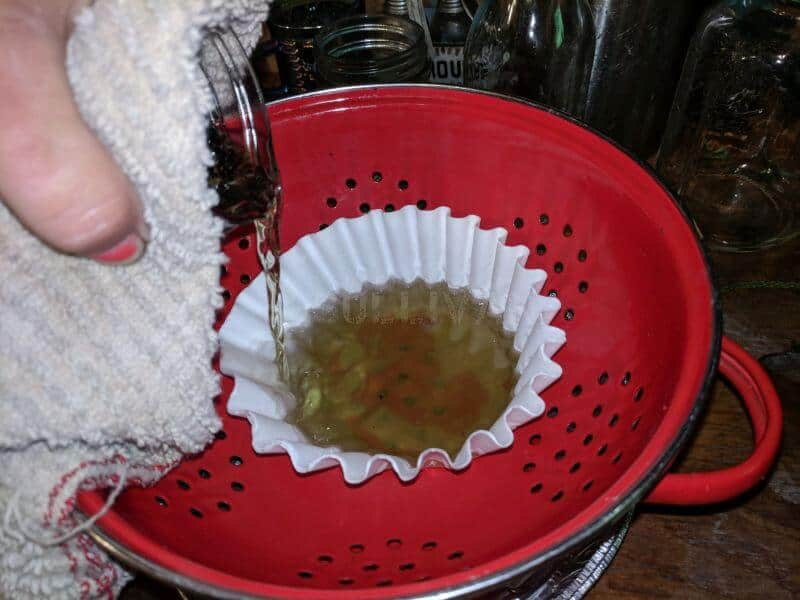 straining the mixture through the coffee filters