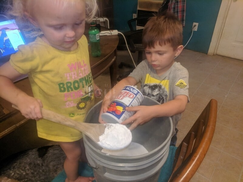 toddlers making a mixture