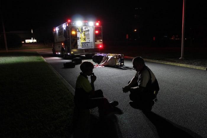 woman showing ptsd next to ambulance