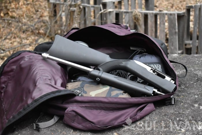 rifle in backpack