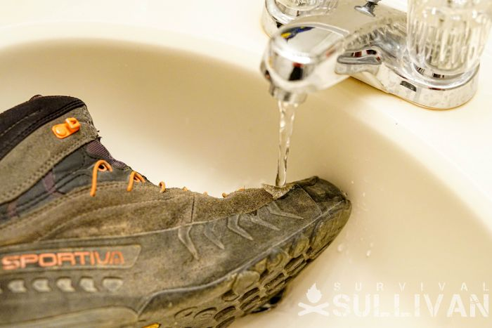 dirty boot under water faucet