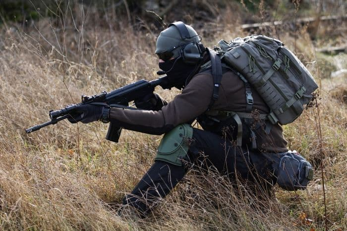 mail with loads of tactical gear