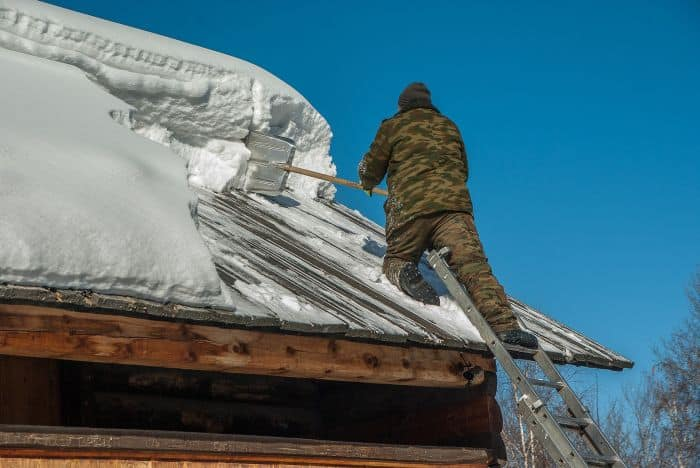 removing snow from roof in siberia