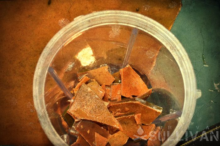 pieces of dehydrated honey in grinder