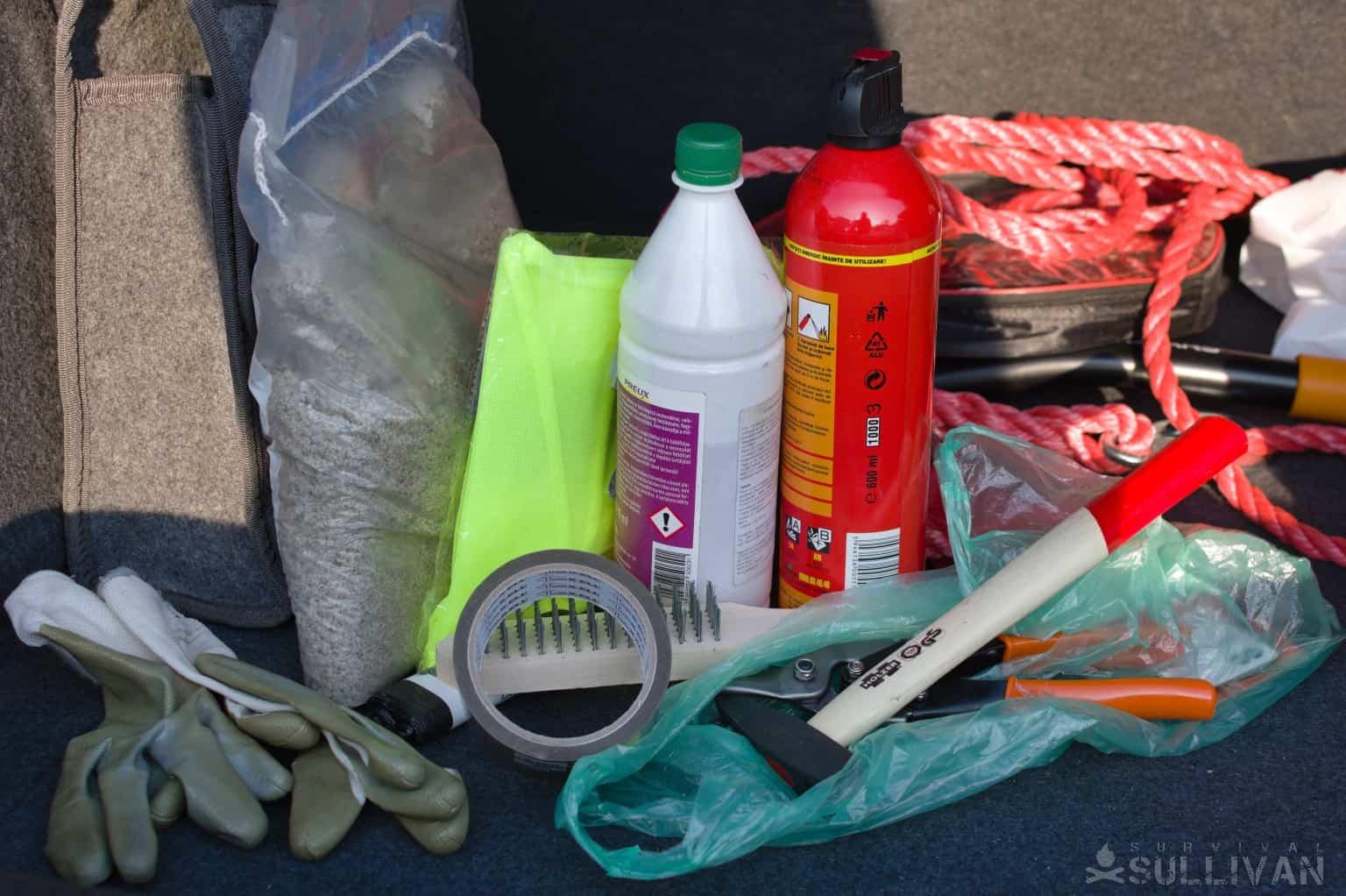 fire extinguisher antifreeze reflective vest hammer gloves duct tape