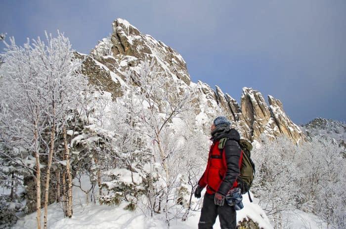 man hiking during winter