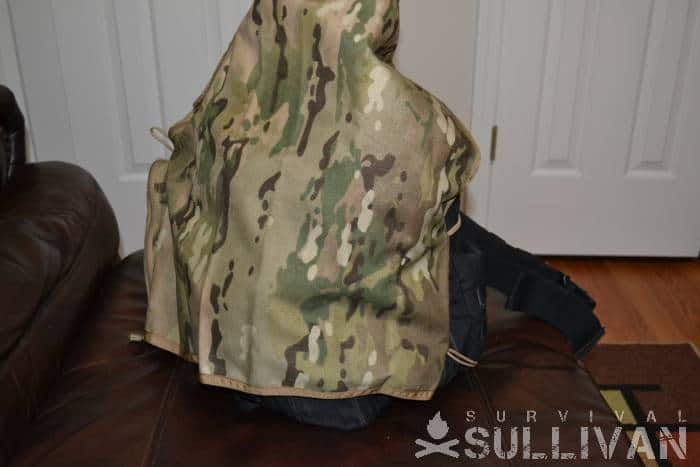 camo tarp over backpack