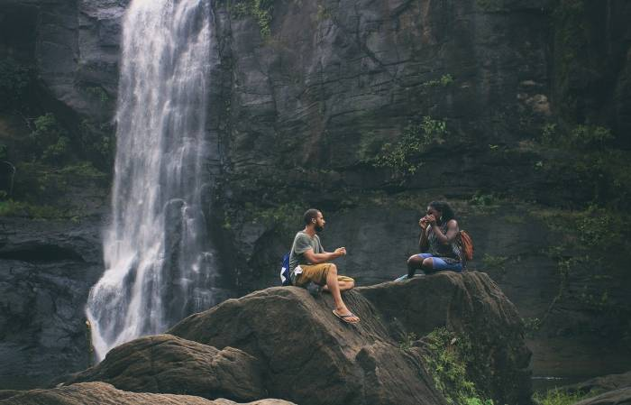 couple next to waterfall