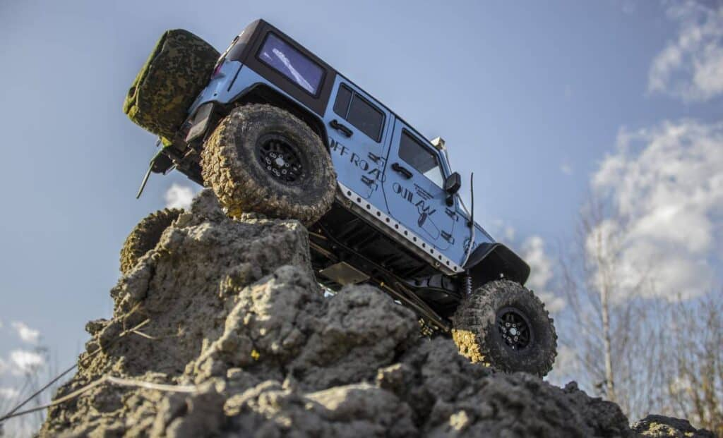 4x4 vehicle on top of some rocks