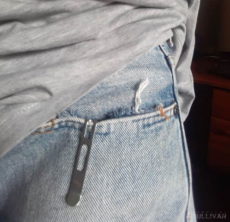 knife clipped to jeans back pocket