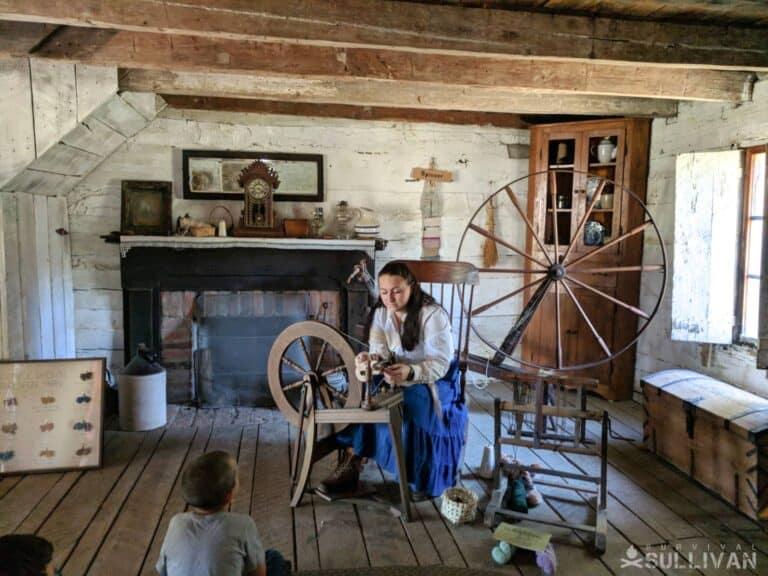 woman showcasing a spinning wheel